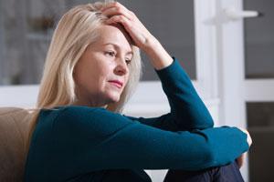sad-depressed-woman-home-sitting
